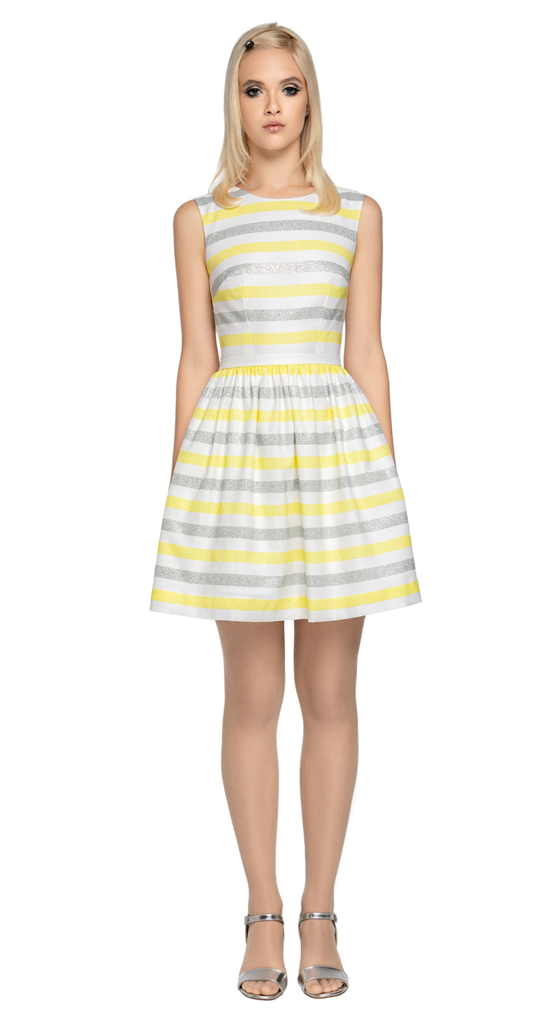 Our retro style, Spring event dress provides just enough dazzle to create an entrance without infringing on comfort.  A gathered skirt with fitted bodice, side pockets for essentials and a beautifully semi exposed back only add to the immediate femininity of this style.   A fully lined piece, with back button closure and back zipper, produced from luxurious French mill fabric with some stretch.