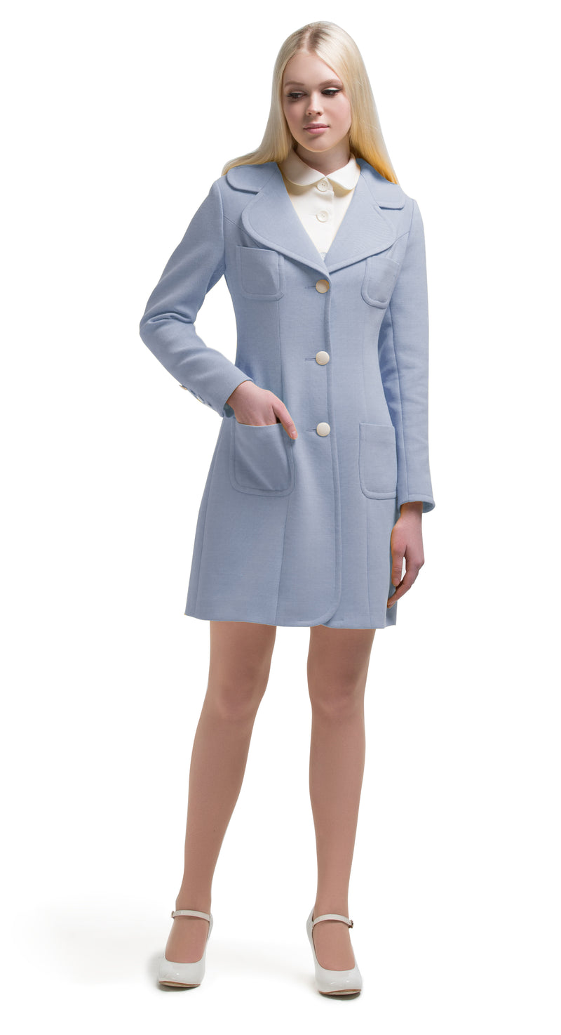 This blue fair weather 60s style coat boasts a flattering classic vintage silhouette. Decorative off-white button detailing on the sleeves, a three-button closure and four functioning pockets establish this as an ideal comfortable companion for outdoor late summer outings. Available in two subtle shades; soft yellow and dusty blue. Pairs perfectly with our button-down dress available in the same palette.