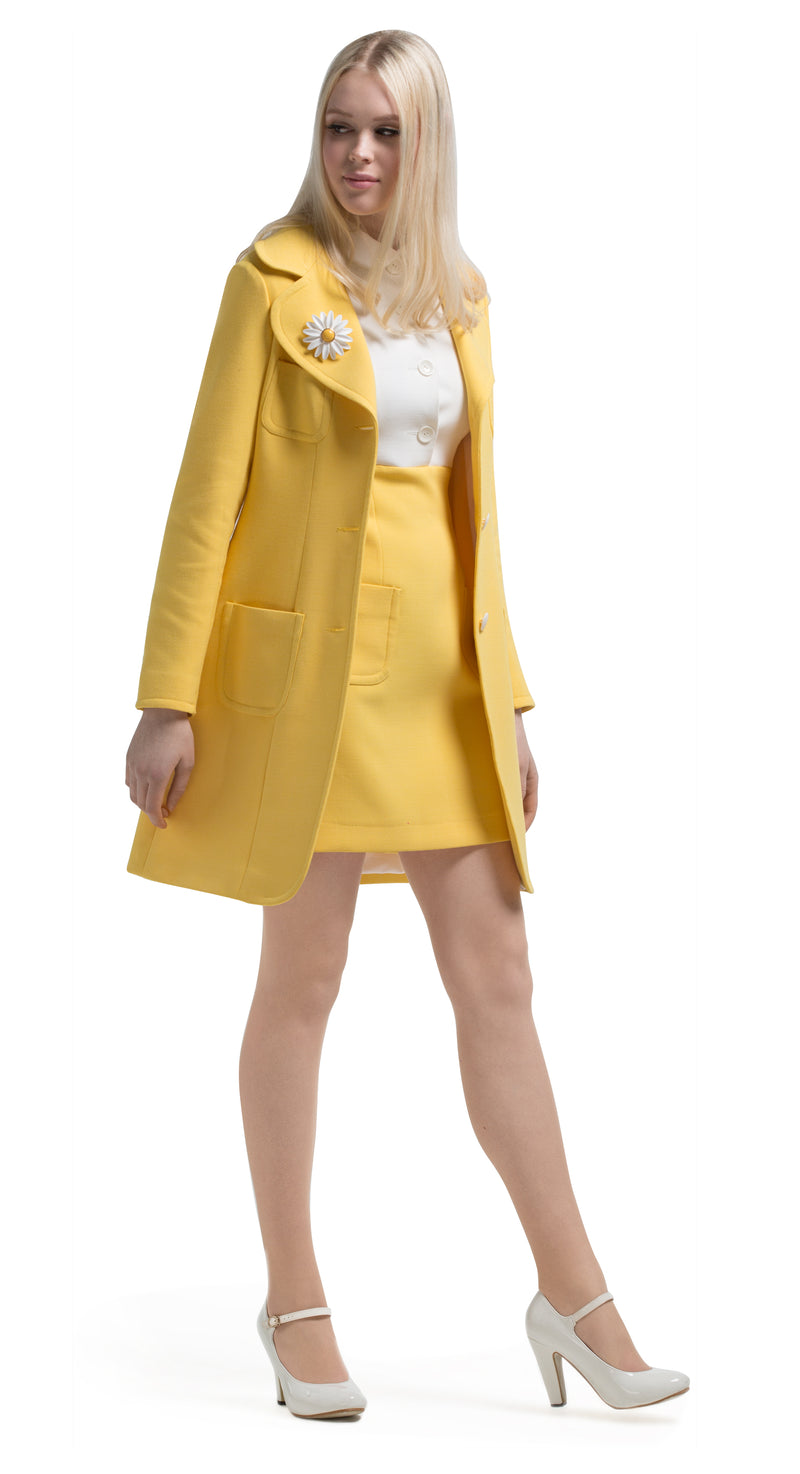This yellow 60s style fair weather coat boasts a flattering classic vintage silhouette. Decorative off-white button detailing on the sleeves, a three-button closure and four functioning pockets establish this as an ideal comfortable companion for outdoor late summer outings. Available in two subtle shades; soft yellow and dusty blue. Pairs perfectly with our button-down dress available in the same palette.