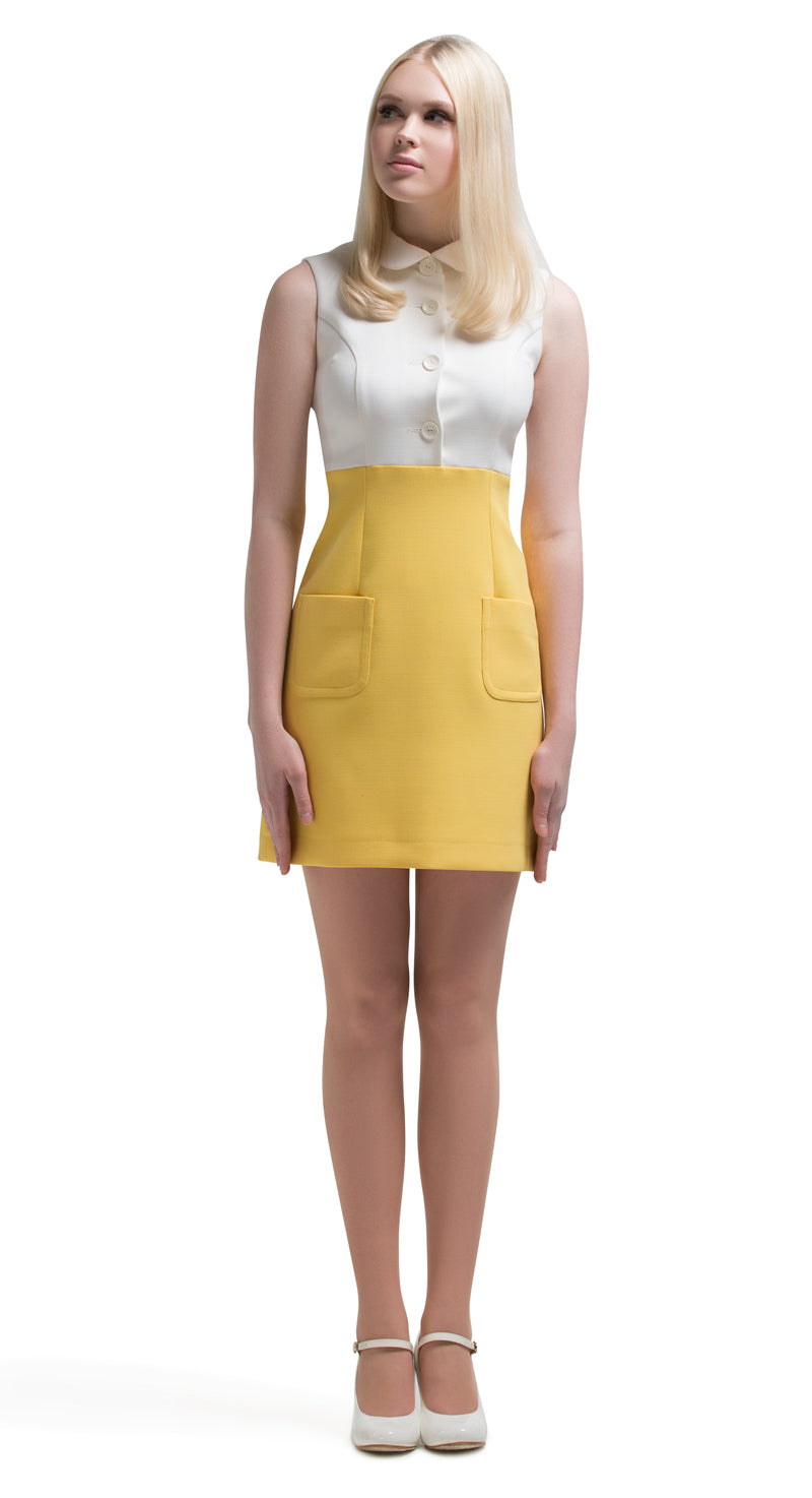 Simple and striking. This straight cut, fitted, 1960s style front button-down dress with 2 functioning pockets is ideal for everyday wear, yet versatile enough for the evening. A fun and feminine piece to be worn as shown in either soft yellow/light cream or dusty blue/light cream. It can be paired with our light weather coat in the same colour tones when the evening draws in to complete the look.