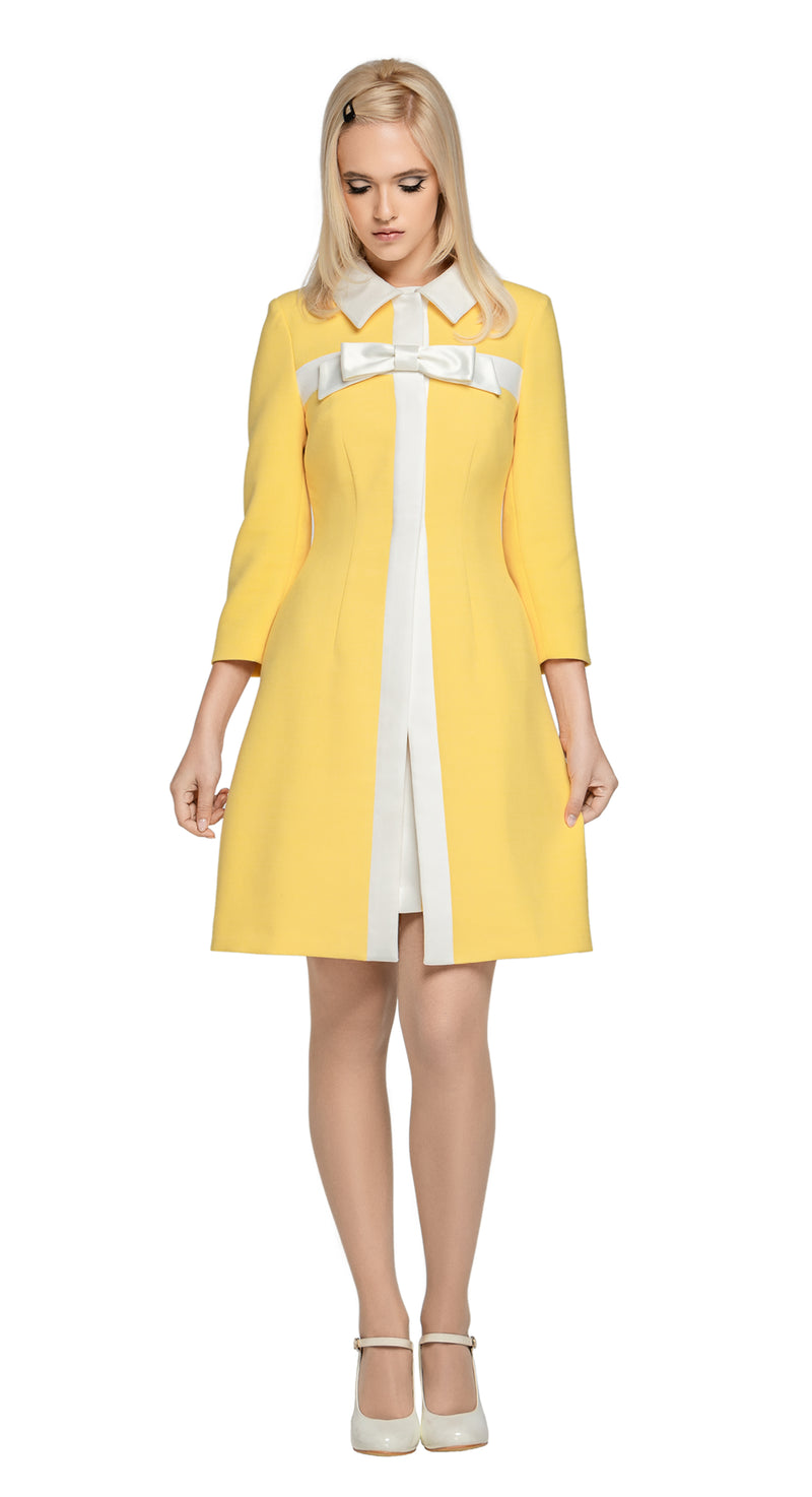 A classic, Spring coat in light yellow Italian fabric with complimenting cream detail. A light cream detachable bow assists in dressing this piece up or down.  This fully lined coat pairs perfectly with our 60s Style Light Yellow/Light Cream Dress.  Choose bespoke to for different colour combinations (please inquire).