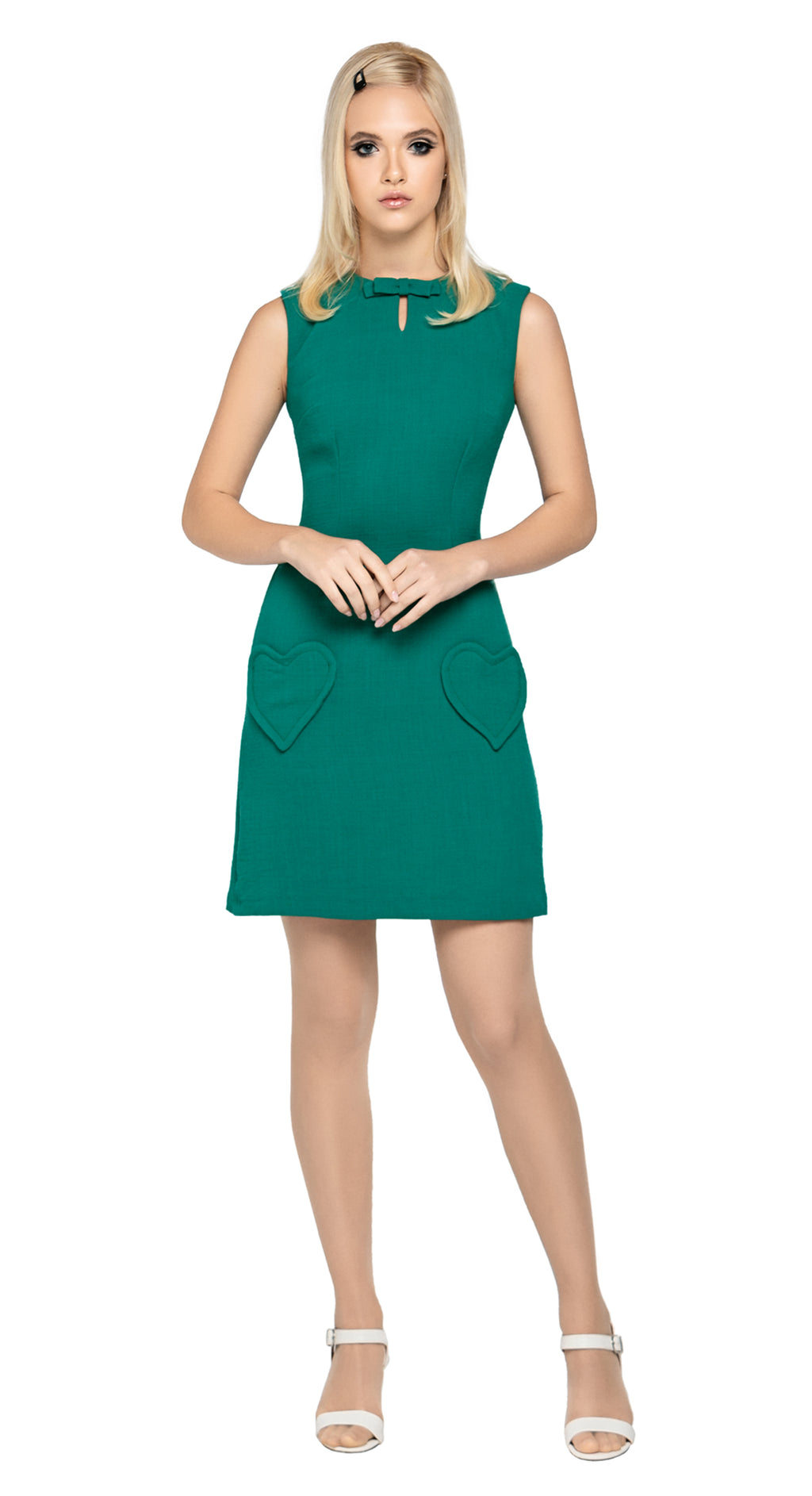 At work or play, fitted Spanish viscose/wool blend dress with unique heart shape functional pockets, delicate bow detailing and a slight cut out at the neckline. A very wearable and flattering style statement in a classical vintage green. A fully lined piece with back zipper closure.  Pairs perfectly with style our Vintage Green Jacket for a high fashion functional statement.  Choose bespoke to add desired sleeve length or for a different colour (please inquire).