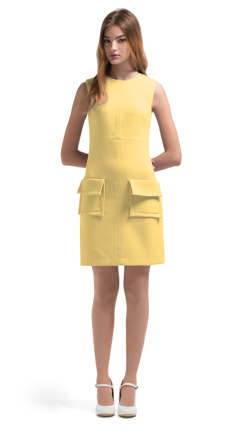 This straight cut, 1960s style, light yellow, fitted dress features 2 large fold-over pockets and beautiful top stitching detail. It is a confident number, elegant in its simplicity and practical for daily wear and from office to social outing. A suggested wardrobe addition for the tail end of summer and into the Autumn. Available in either light yellow or dusty blue.