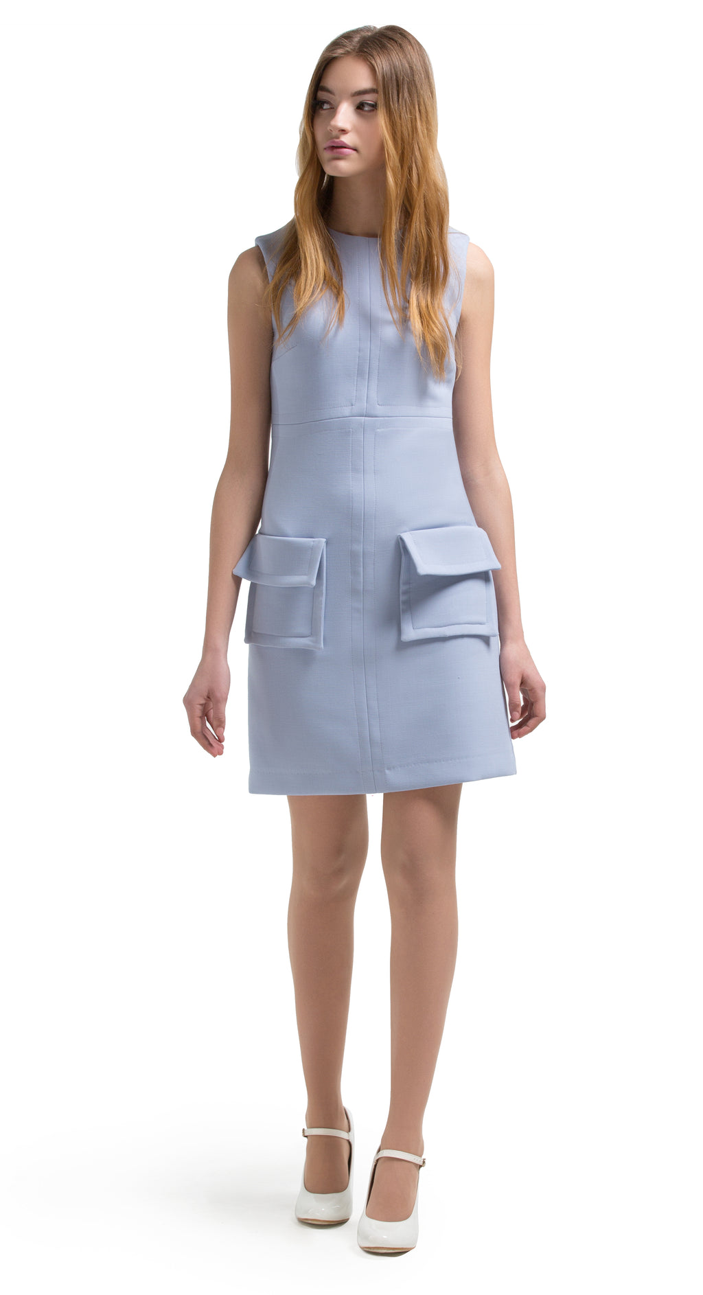 This straight cut, 1960s style, dusty blue, fitted dress features 2 large fold-over pockets and beautiful top stitching detail. It is a confident number, elegant in its simplicity and practical for daily wear and from office to social outing. A suggested wardrobe addition for the tail end of summer and into the Autumn. Available in either dusty blue or light yellow.