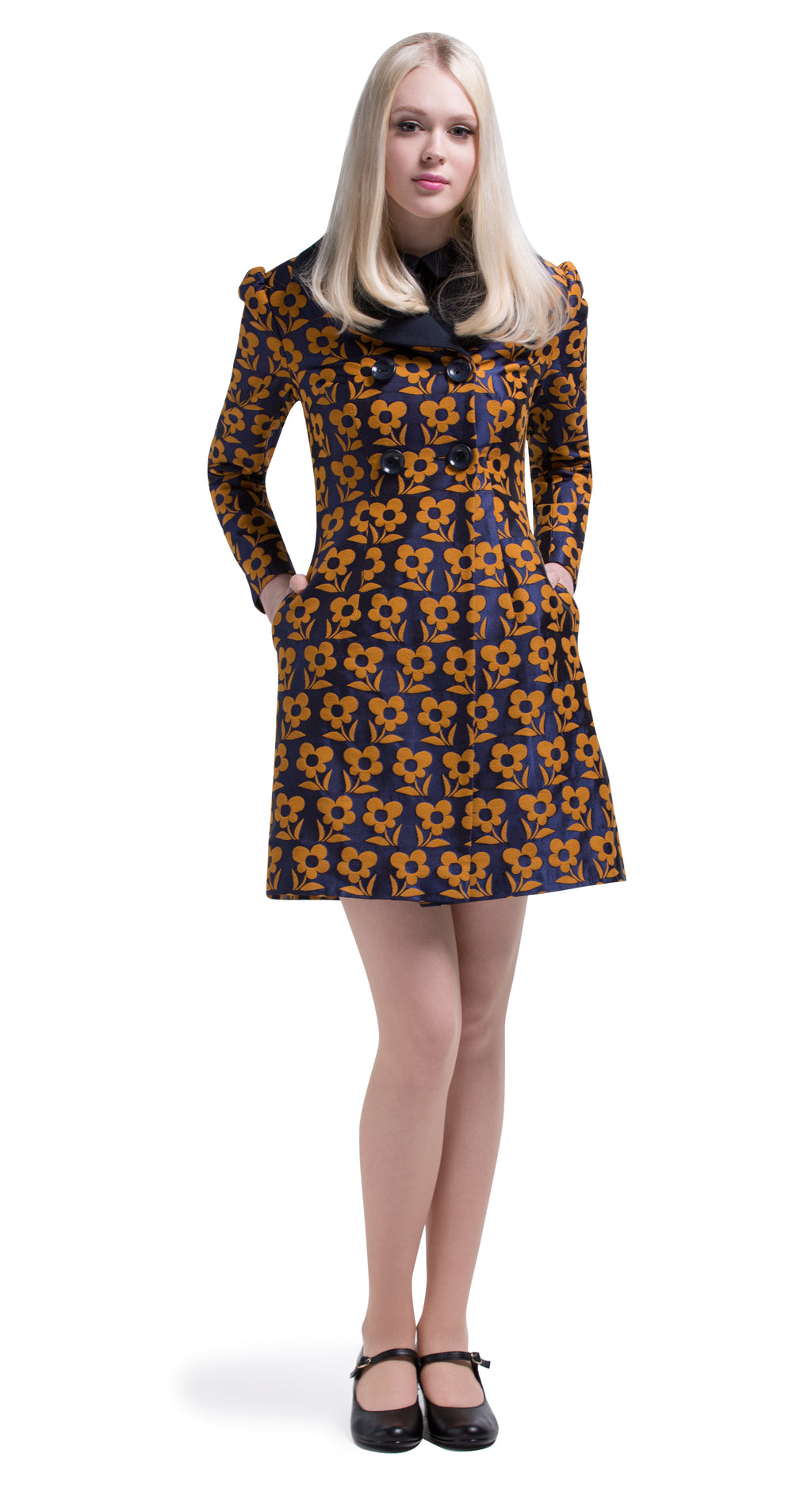 This double-breasted Autumn coat in a medium weight French weave navy blue and mustard brown floral weave has a slight puff to the sleeves and two functioning side pockets with a 4 button closure.  This piece pairs perfectly with its matching counterpart dress or can be worn as a light accompanying coat over darker spectrum dresses.