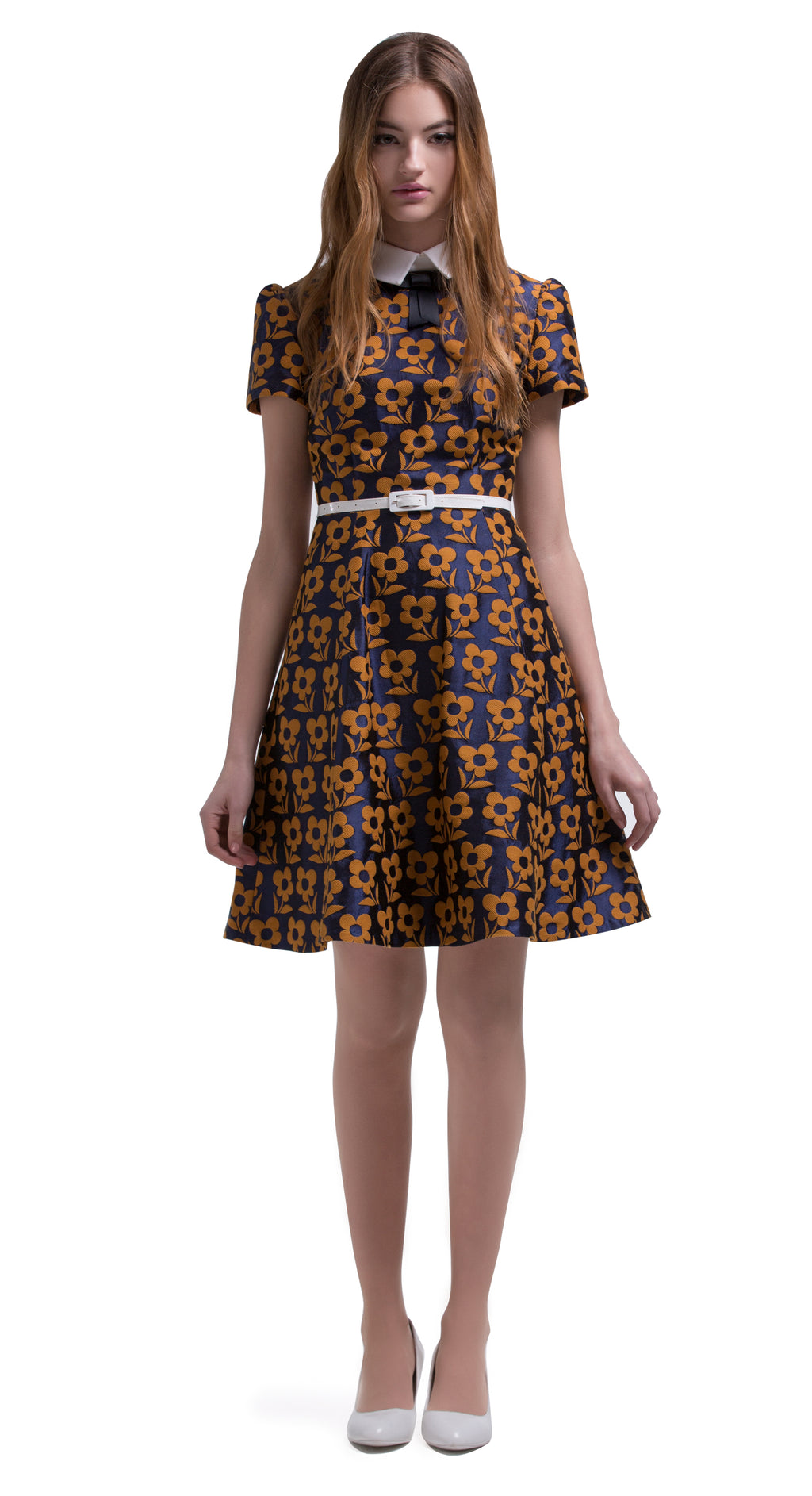 This fitted vintage style party dress is made of a medium weight French floral weave, broken up by a detachable white belt and simple white collar with a small blue bow and slightly puffed sleeves. Navy blue and mustard brown Autumn colours. Pairs well with the coat of the same fabric or as a stand-alone entrance maker.  Choose bespoke for alternative sleeve length, flair or red floral and light copper colour tones.