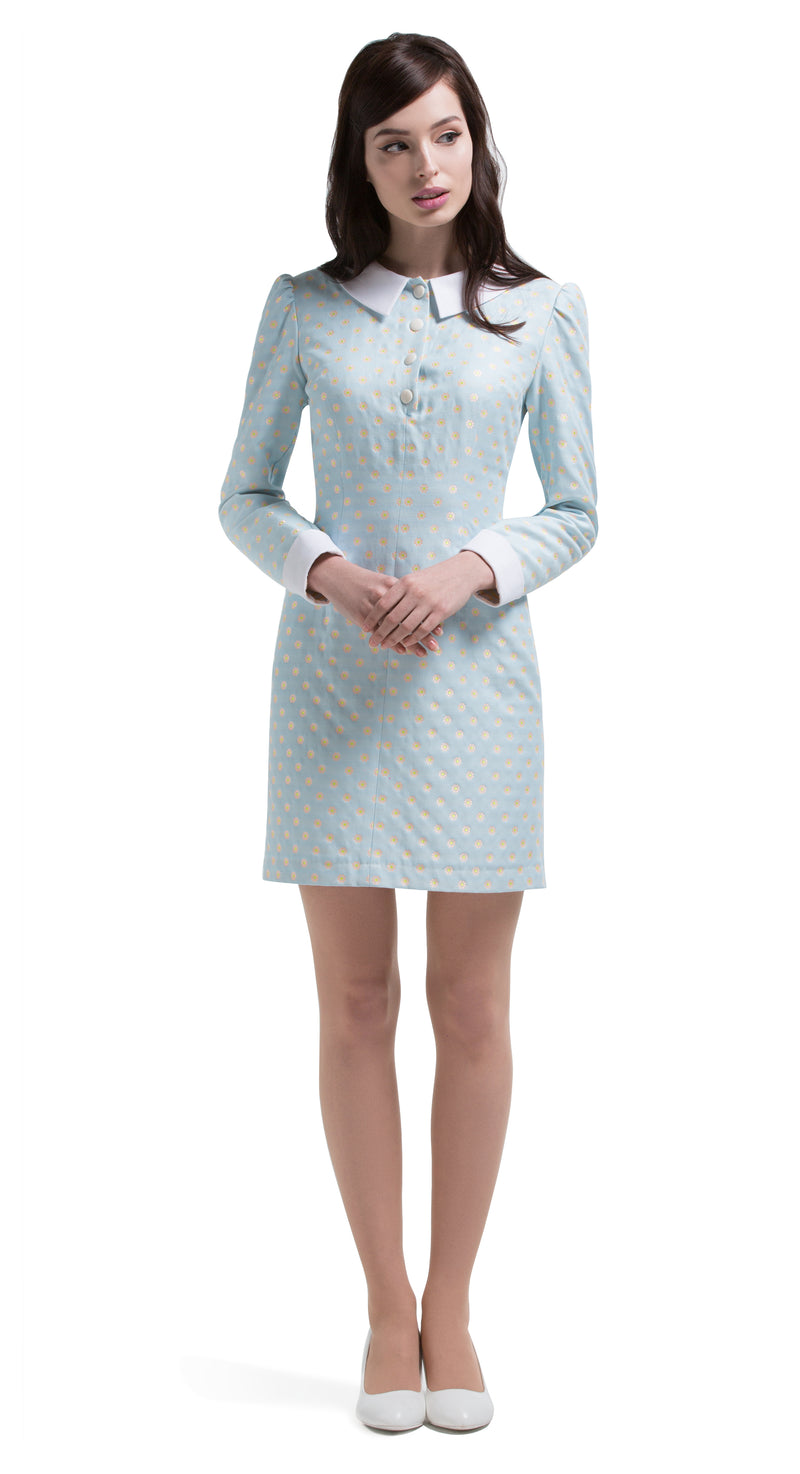 Adorable and immediately feminine, a true nod to summer. This beautiful, 1960s style, flower pattern, fitted dress lends itself to confidence through flattering simplicity. The slightly puff sleeves and perfectly placed decorative buttons below the timeless white collar create a charming sixties style cut for modern day or night. Constructed out of a stunning light sky blue with pink/yellow flower French mill weave fabric.