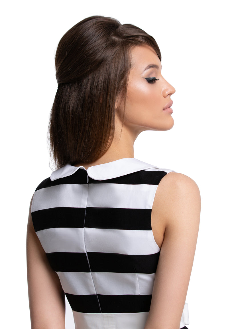 This black and white striped Spring medium-weight French fabric dress can be worn as confidently in the work place as out on the town. A vintage inspired sleeveless number has a fitted bodice, a gathered waist and flared skirt that draws attention to the white bow above the waistline.   Choose bespoke if preferring capped or mid length sleeves.