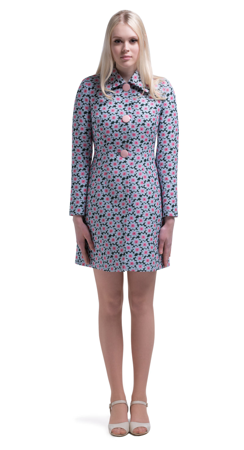 This straight cut sixties dress with short sleeves and animated buttoned belt is made of a medium weight French weave fabric in a floral pattern; dark green, pale blue and pink. Pairs perfectly with the coat of the same fabric to complete the set or as ideal Autumn wardrobe addition for work or play.  Choose bespoke for sleeve length options or to alternate to the a brown/orange/grey floral pattern.