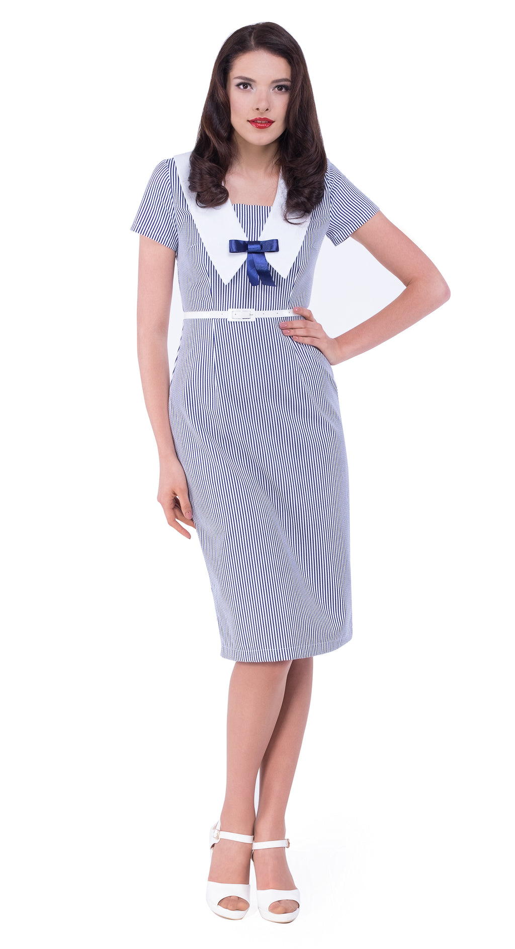 This Spanish cotton blend 50s style fitted full length dress is detailed by a vintage nautical collar and a punch of colour by way of a blue bow and completed with a faux leather white belt.  This is a very breathable and comfortable summer to autumn casual wardrobe addition.