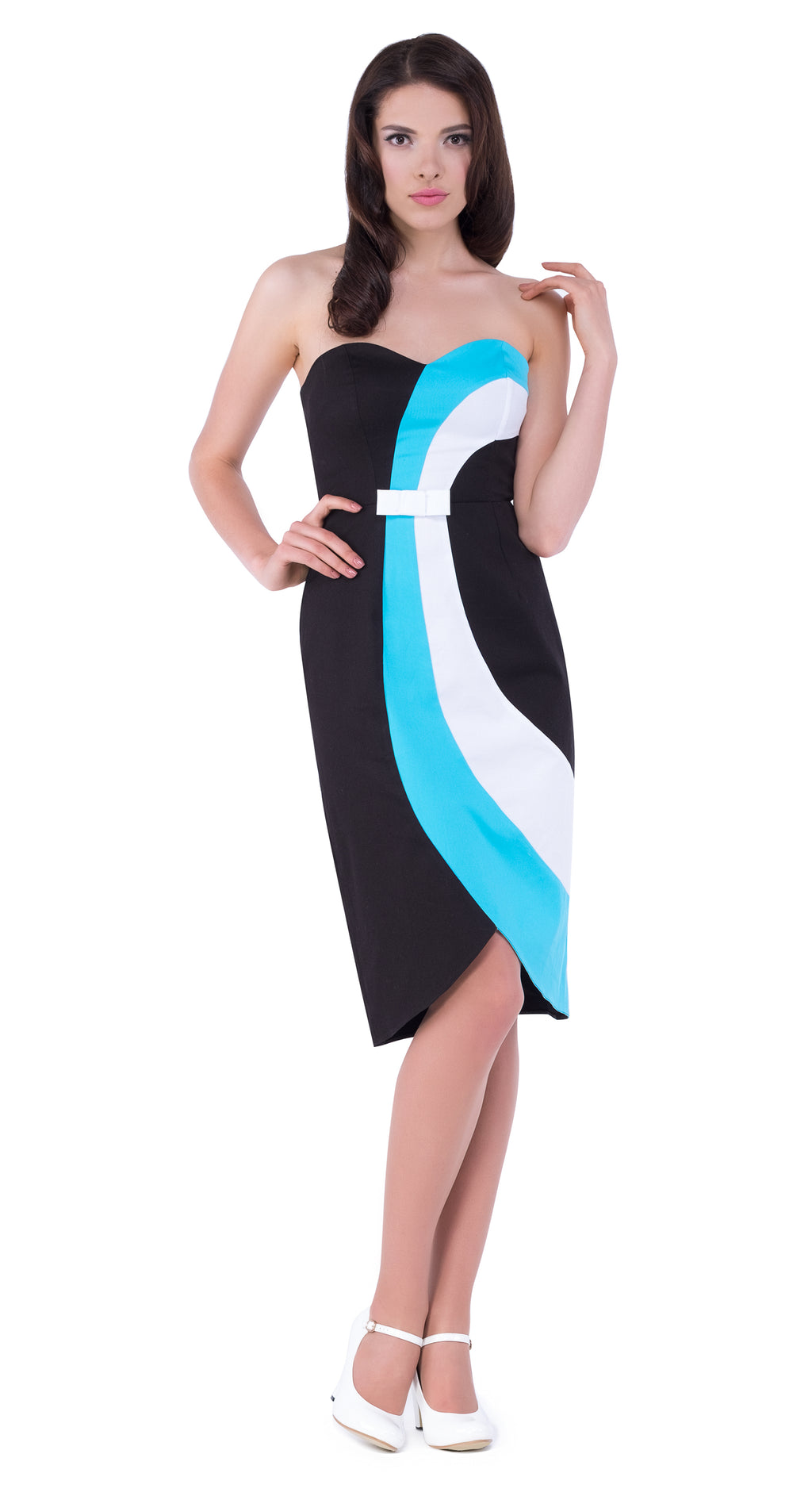 This chic vintage style cocktail dress boasts a striking profile through use of shape and colour. Two waves of colour navigate the curves of the body.  In addition to detail within the cut, a small bow on the bodice adds a cute finish. Made of Italian cotton. A timeless style throughout seasons for as and when the moment to dress up strikes.