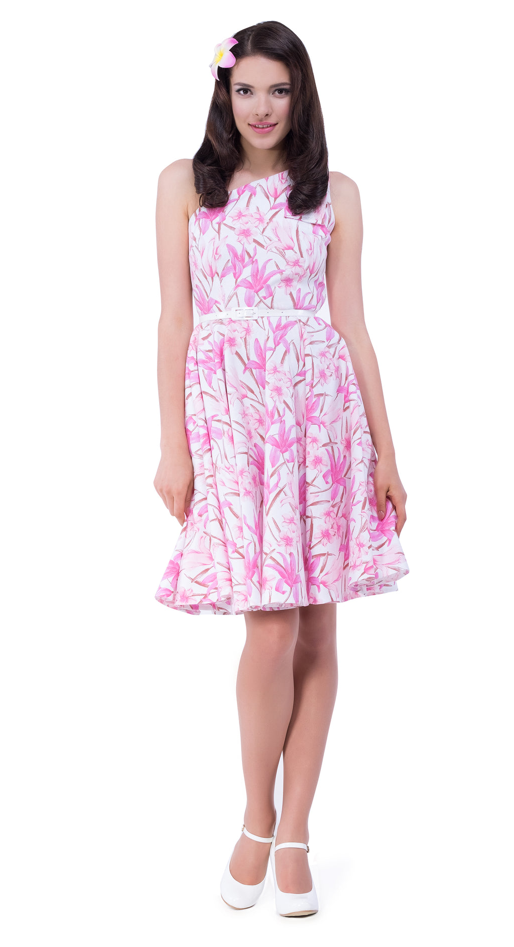 This fitted 50s tiki floral pattern Spanish fabric dress has a large bow on one shoulder to compliment the simplicity of the flattering cut. A vintage style cocktail dress with angled neckline; easy to dress up for more memorable events by way of heels and clutch. Finished with a white faux leather belt and available in as shown pink or turquoise.