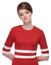 This at work or at play red Italian medium weight jersey, sixties style dress is broken up by two contrasting white stripes on the waist and on the sleeves. A very flattering quality jersey provides a generous give to compliment any silhouette. Also available in black/white.