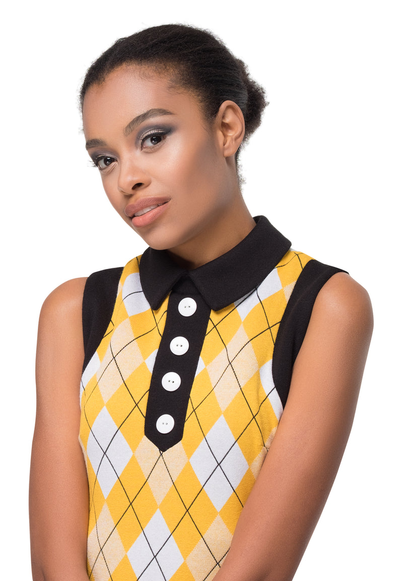Yellow, white and black pattern fitted jersey dress with black contrast and four button detail. This fitted argyle pattern Italian jersey dress is flattering and comfortable both at work or play; a vintage aesthetic of sixties influence. Dressed up with heels, or down with flats, this dress is immediately flattering on all silhouettes due to the jerseys generous give.
