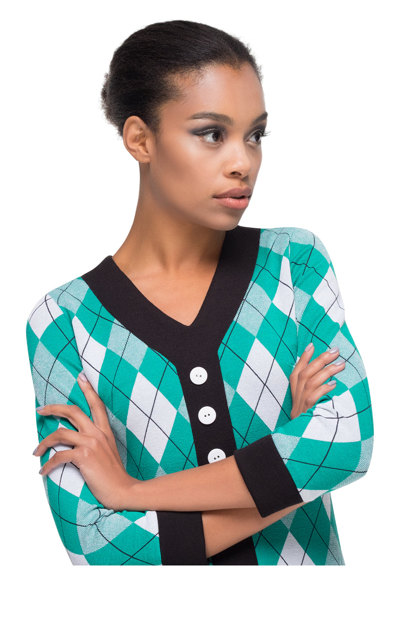 This v-neck argyle patten, fitted dress with black contrasting skirt, neckline and cuffs, three quarter length sleeves and eye catching 3 button details is made of high quality Italian jersey which provides a generous give for a flattering fit across all silhouettes. A piece that will prove versatile in both work and play; a sharp and cool style, dressed up or played down for cooler Summer evenings and into Autumn.
