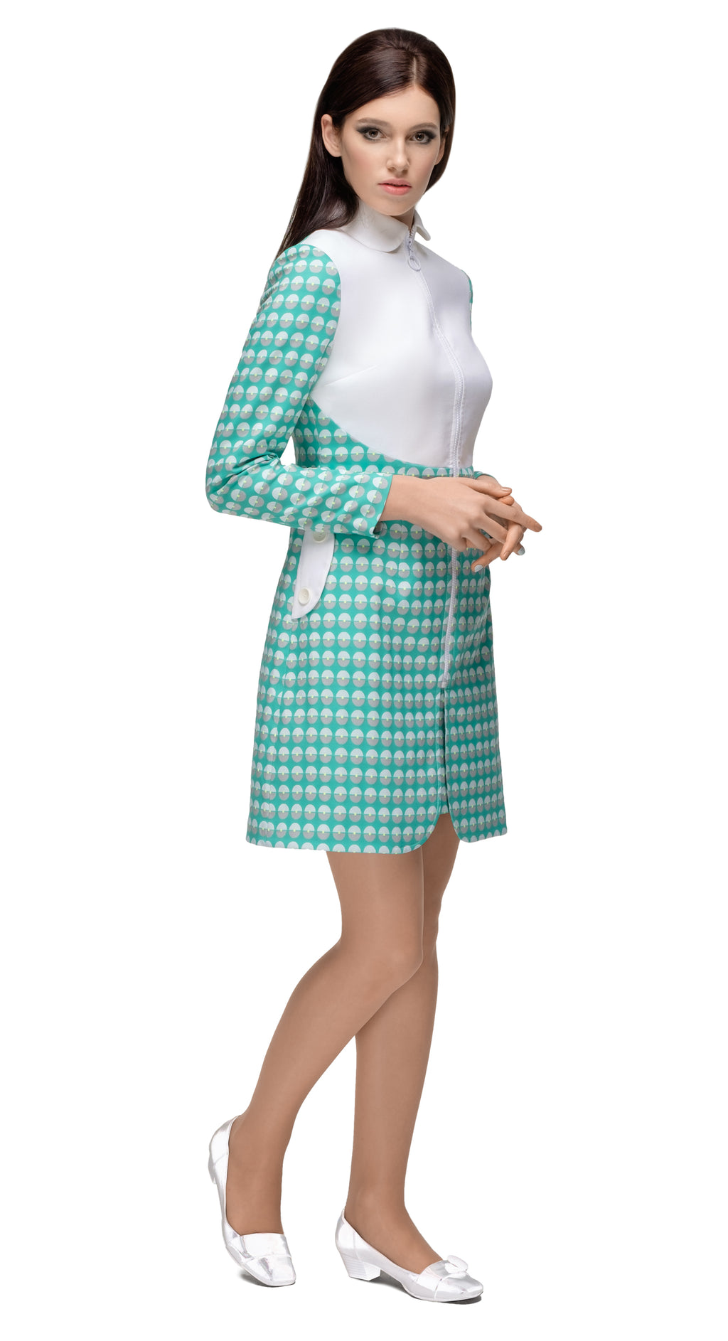 This a-line coat with a striking contrast between a beautiful French weave fabric and the pure white body perfectly displays  the form and cut of sixties style. Detailing by way of functioning side pockets and a looped vintage style front zip closes this fair weather coat off perfectly. Pairs with the matching dress of the same theme.