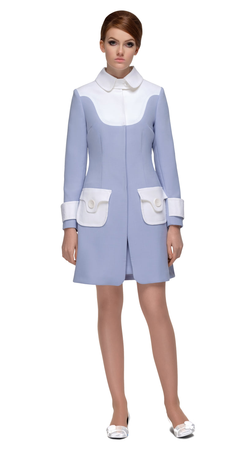 This fitted two tone sixties coat with functioning button pockets and collar closure is made from quality cream and dusty blue Italian mill fabric that lends itself beautifully to the eloquent shape of the cut. Paired with the matching dress of the same description, this set is an ideal consideration for both casual and formal events. Suited for both casual and formal events when the occasion calls for a stylish statement to be made simply and effectively.
