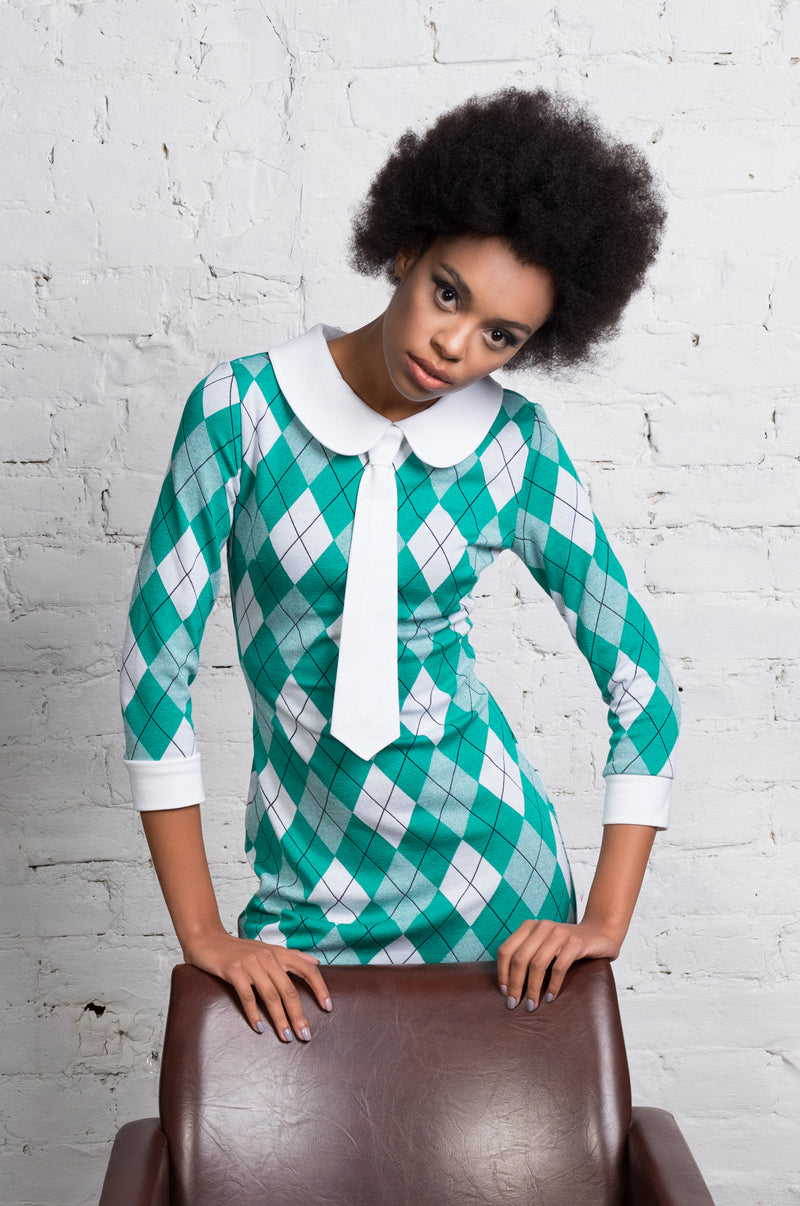 A perfect Spring and in to Autumn argyle Italian pattern jersey dress. This quality jersey provides generous give, making for a flattering and comfortable workday or evening out dress.  With vintage detailing by way of contrasting white cuffs, collar, a detachable tie and decorative retro sixties style belt makes this dress an all function style.