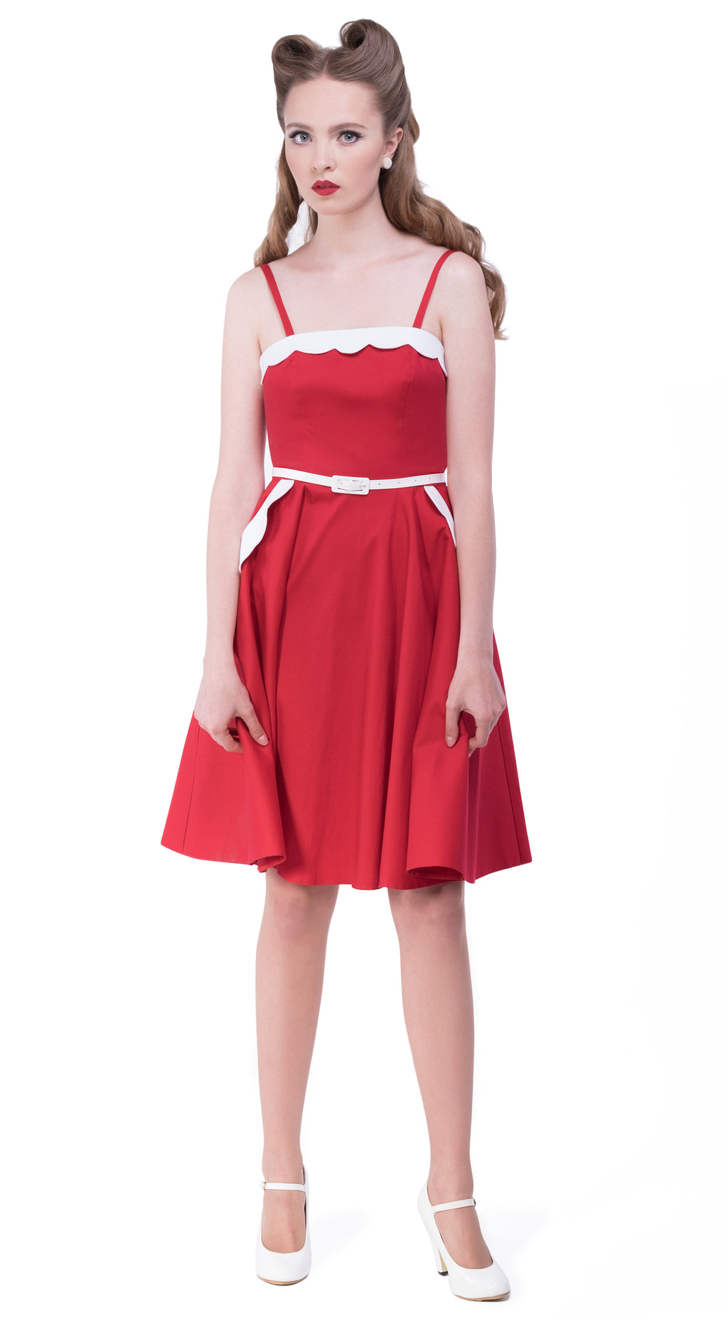 This red rockabilly 50s style Italian cotton dress from the first season of Magdalena's Main Squeeze label provides a fitted bodice with full length circle skirt, incorporates impacting detail by way of a darling white scallop top and scallop pockets, detachable ballerina shoulder straps and a white faux leather belt.