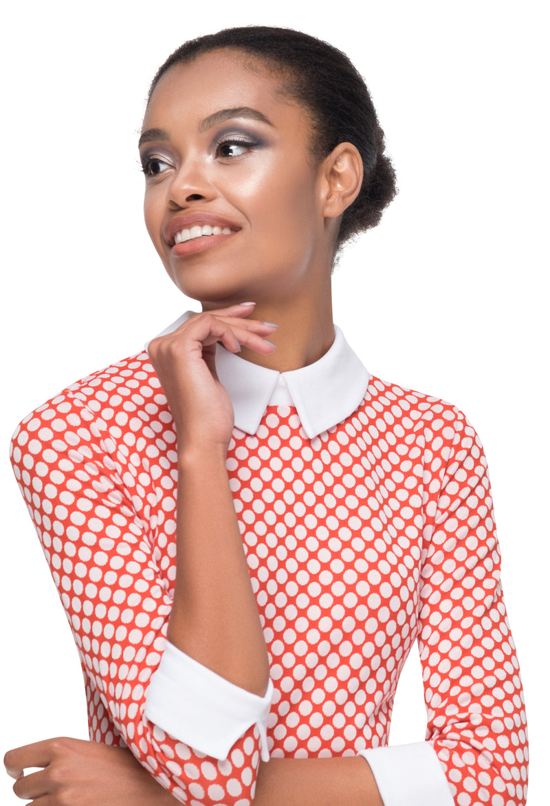 This polka dot pattern, fitted Italian jersey mod dress allows for true comfort and generous give. Three quarter length sleeves with a white contrast on cuffs and collar, finished with a white faux leather belt blur the lines between a vintage and modern aesthetic. A versatile piece at home, in the office or on a night on the tiles.