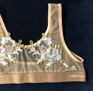 Nude sport style bra top with 2 patches of Champagne bottles spraying out on the front