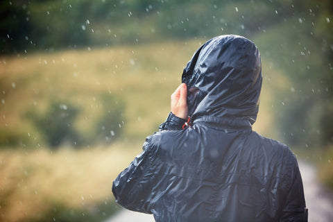 A shot of a hiker in a rain jacket.