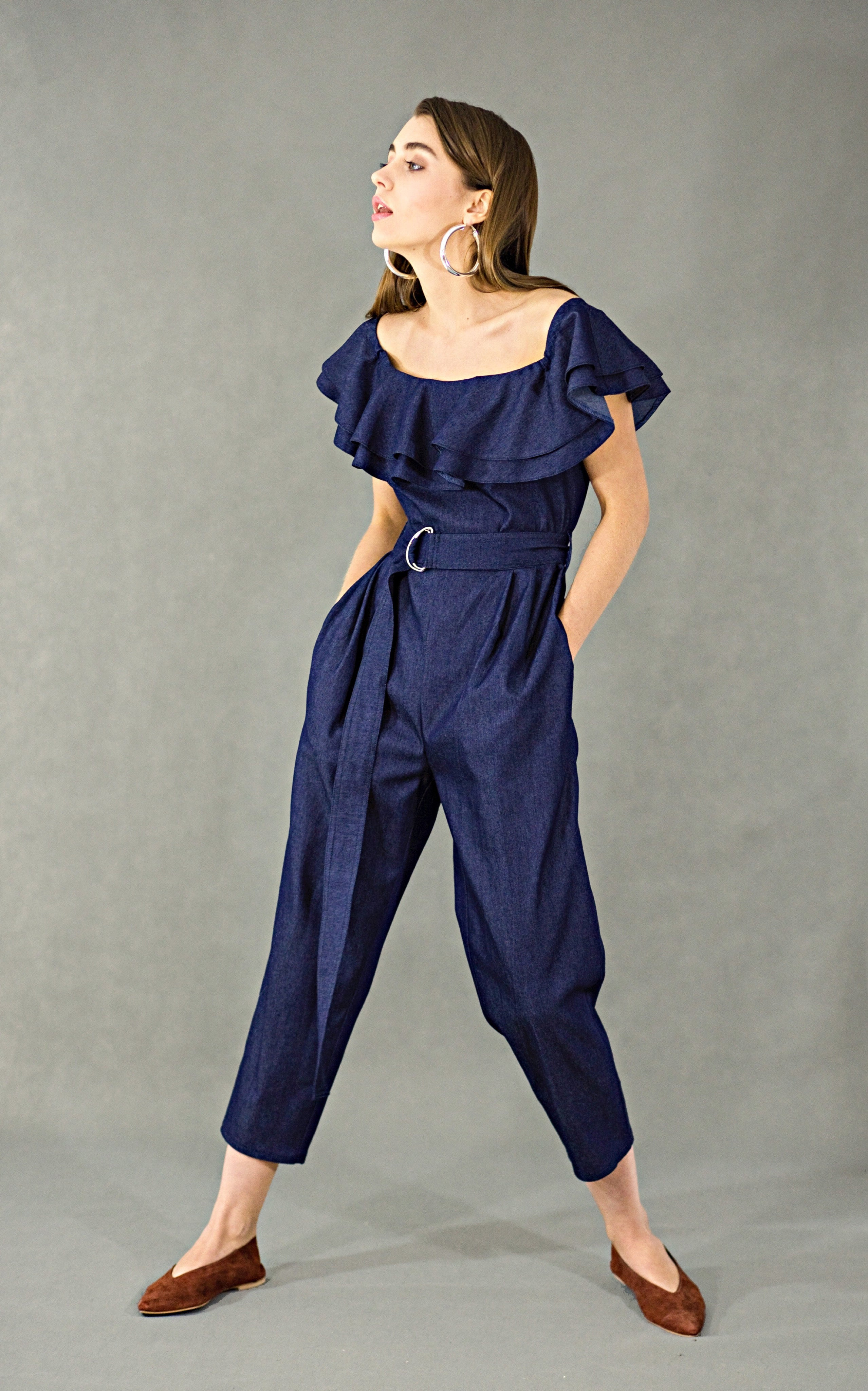 Double ruffled off-the-shoulder denim jumpsuit