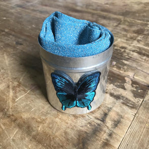 Havana blue socks in a large sapphire butterfly tin