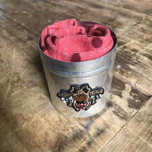 Madrid carnival coral socks in a large jewel insect tin
