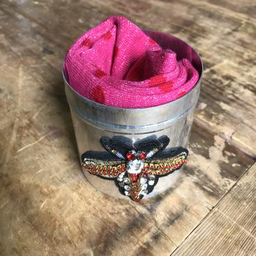 Madrid carnival pink socks in a large red insect tin