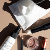 Bodyography Beauty Editor Go-To Collection: From top to bottom - 10 count Cleansing and Soothing Wipes, Mini Ready Set Go Makeup Setting Spray, Lip Pencil in Pouty, Glitter Pigment in Celestial, Inner Glow Stick, Fabric Texture Lipstick in Chiffon