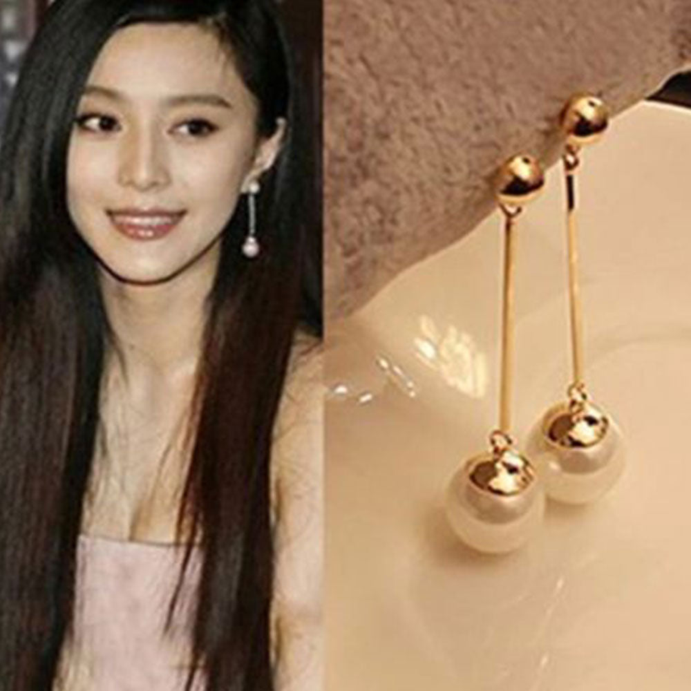 Shopping Mania Long Section Pearl Earrings