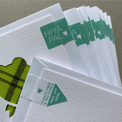 greeting cards packaged with a recyclable paper seal