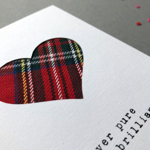 close up of Scottish tartan card by Hiya Pal