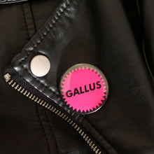Neon pink gallus badge on leather jacket