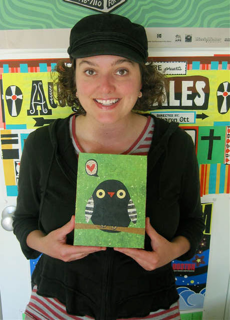 Kate Endle holding artwork