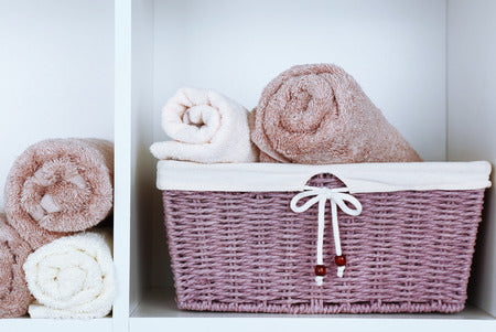 Baskets on shelves with towels