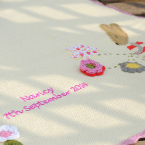 Personalised knitted baby blanket with rabbit