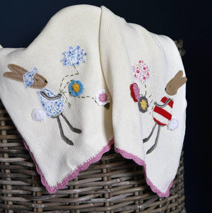 Personalised knitted Powel and Craft baby blanket, with rabbit motif.