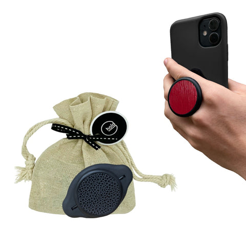 G-Hold Phone Holders come in sustainable linen gift bags which is the most sustainable packaging option. Image shows phone being held with the G-Hold Phone Holder in the most ergonomic way to hold a phone to prevent hand and wrist strain caused by using other pop-out phone grips.