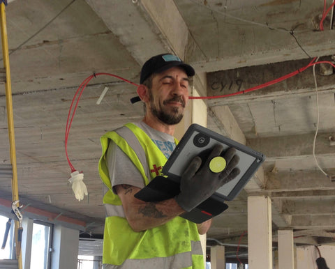 Durable G-Hold Tablet Holder being used on construction worker's iPad