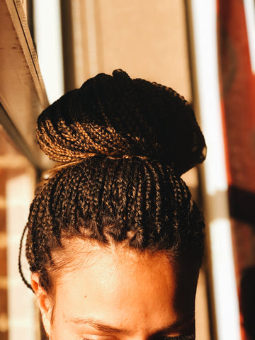 high bun with box braids TIY hair tie maintenance of braided hair style