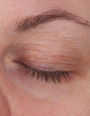 Fake aging using wrinkles on the eyelis created using OSP special effects makeup.