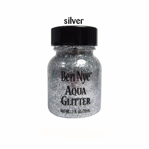 silver glitter suspended in liquid