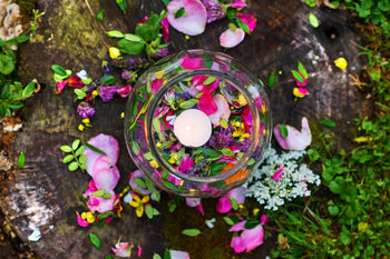 Water with petals and candle for aromatherapy