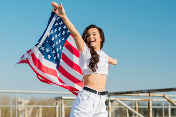 Happy girl holding the American flag