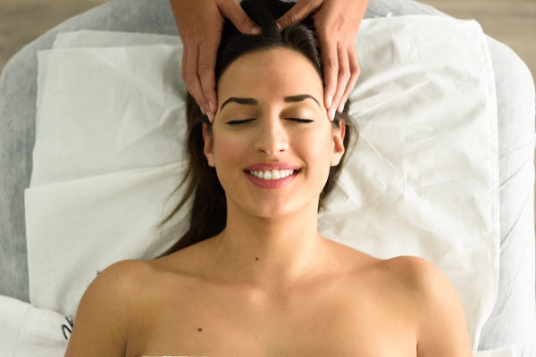 Woman getting a head massage