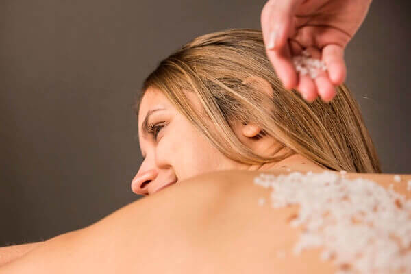 Using body scrub on back