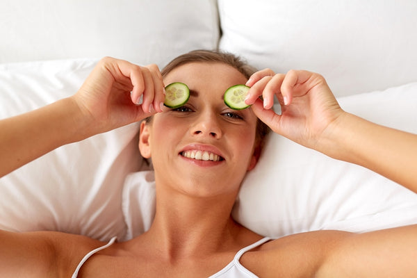 Woman with cucumber in her eyes