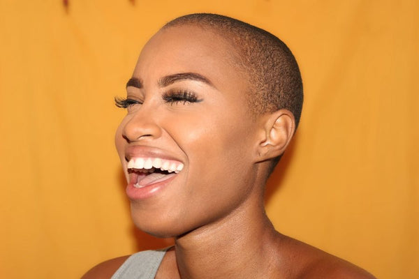 Bald women laughing